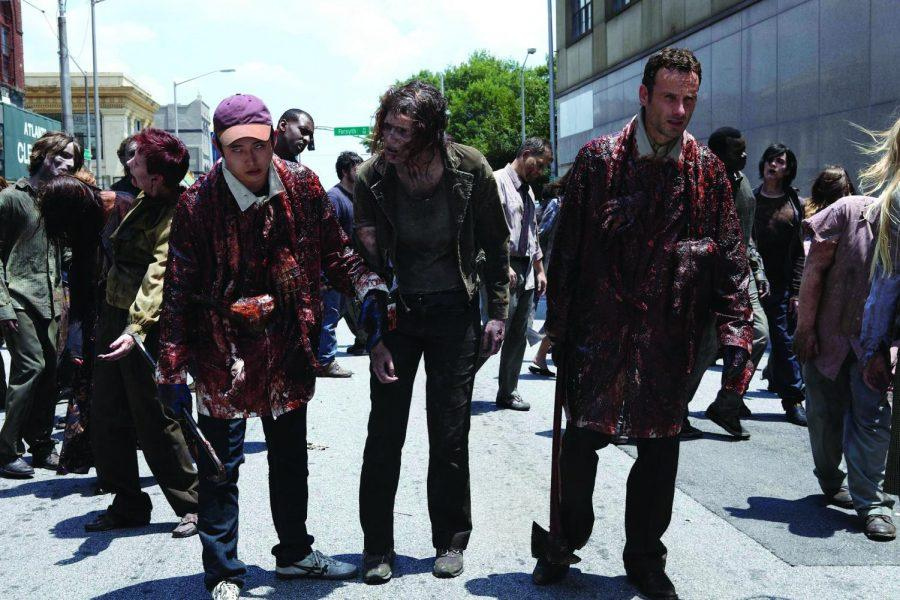 In+this+publicity+image+released+by+AMC%2C+Steven+Yeun%2C+left%2C+and%0AAndrew+Lincoln%2C+right%2C+try+to+blend+in+with+the+zombie+population%0Ain+a+scene+from+%22The+Walking+Dead.%22+%28AP+Photo%2FAMC%29%0A