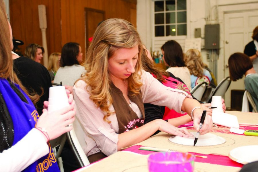 PAINTING FOR A CAUSE — Event attendees work on their art projects at Relique, as the night helped raise money to send two children with cerebral palsy to a camp for disabled people.