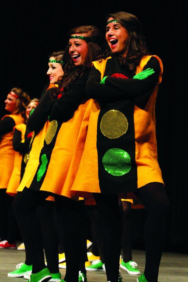 Two Alpha Gamma Deltas pose during a routine. The sisters of Alpha Gamma Delta won first place in the womens division in 2011.