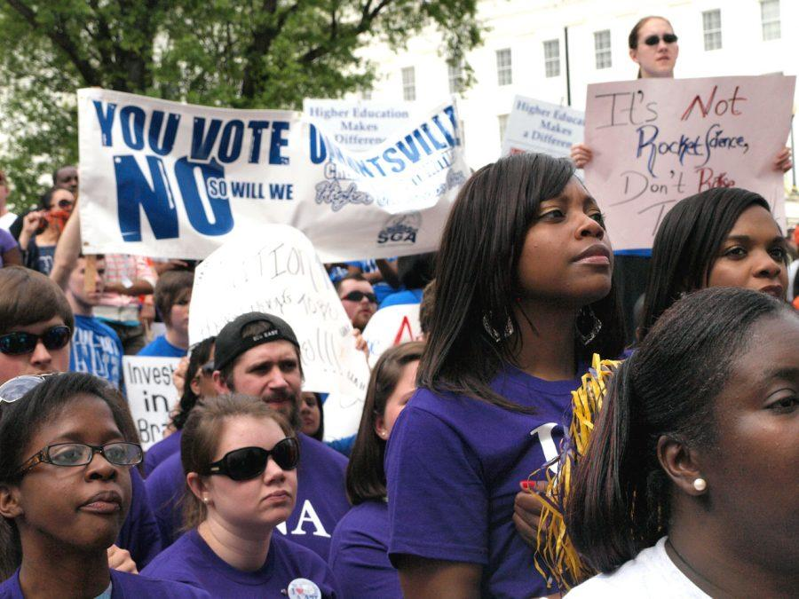 UNA students look on as Gordon Stone, executive director of the Higher Education Partnership, speaks to the crowd.