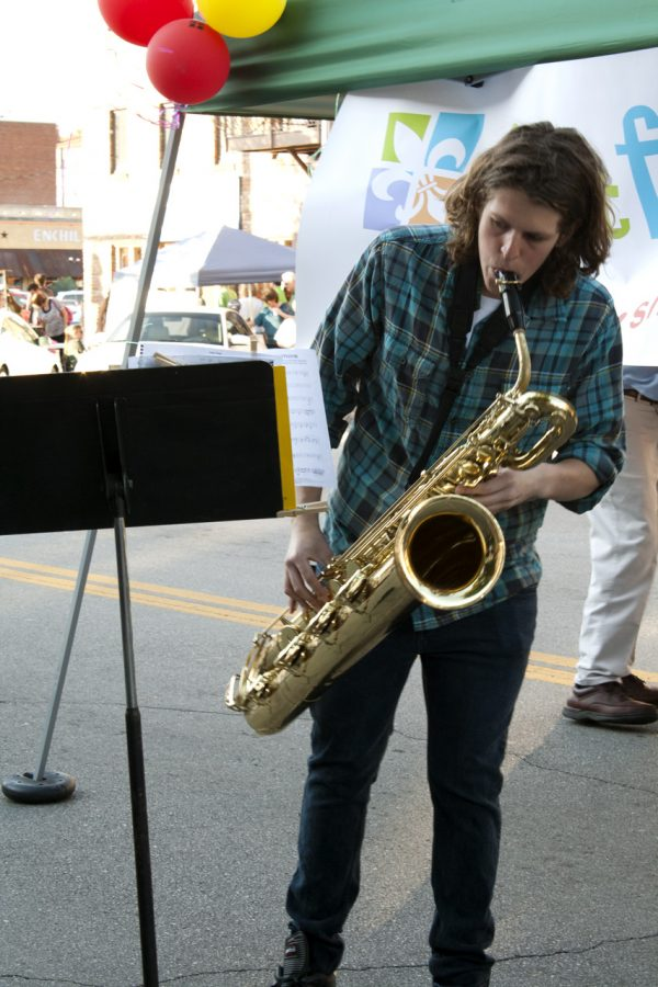Michael Carter beasting a saxophone.
