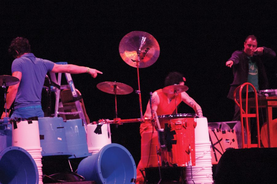 Three+members+of+Recycled+Percussion+perform+on+their+vast%0Aassortment+of+trashcans%2C+paint+buckets%2C+ladders+and+cymbals.%0A