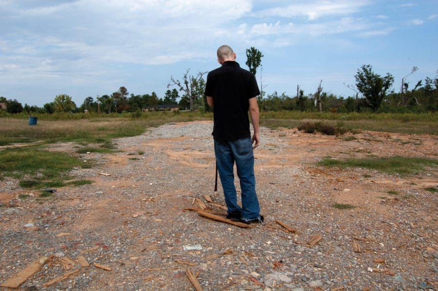 Bobby Schiavi (above) walks through the tornado-damaged parts of Harvest five months after the storms.