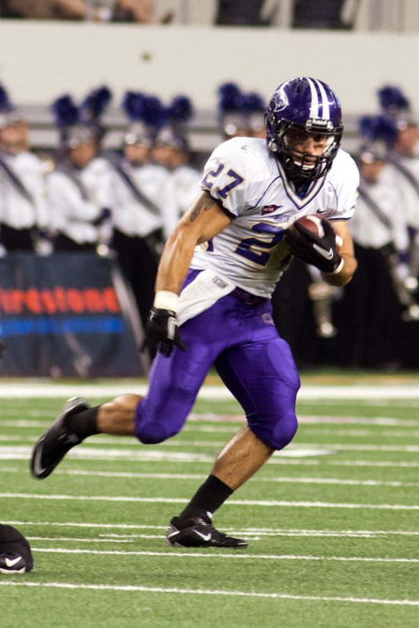 Senior running back Wes Holland runs the ball down the field earlier this year.