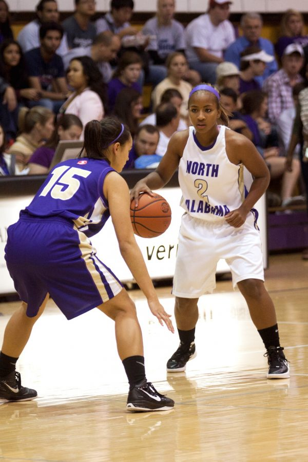 Sophomore guard Jazmine Saxton prepares to make a move during last weeks purple and white game. The Lions look to build off last seasons success and use that for this season.