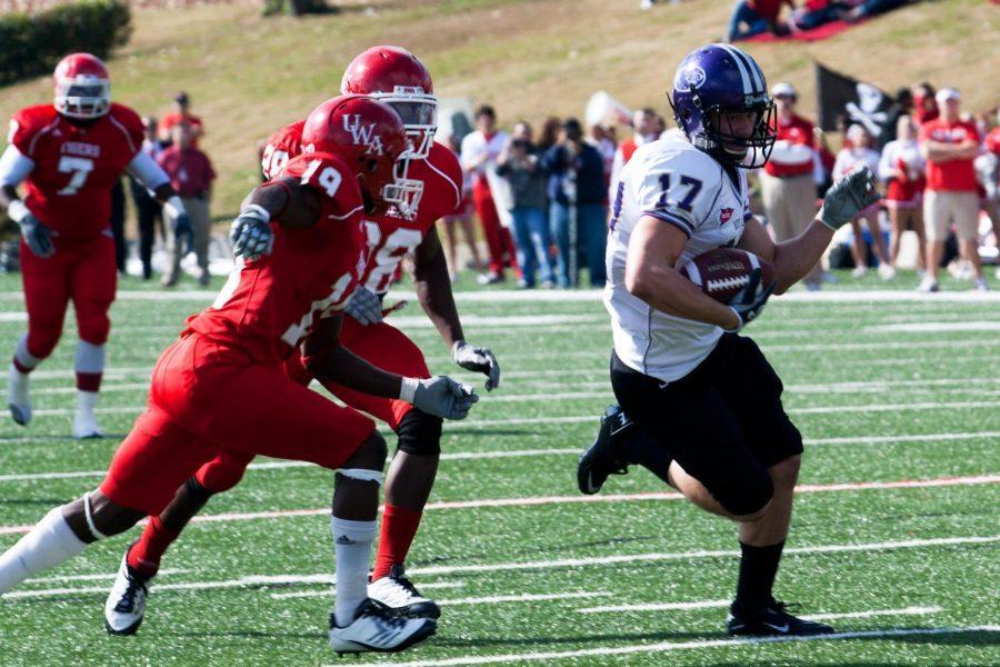 #17 Daniel Almon runs the ball during the Nov 19 game at West Alabama.