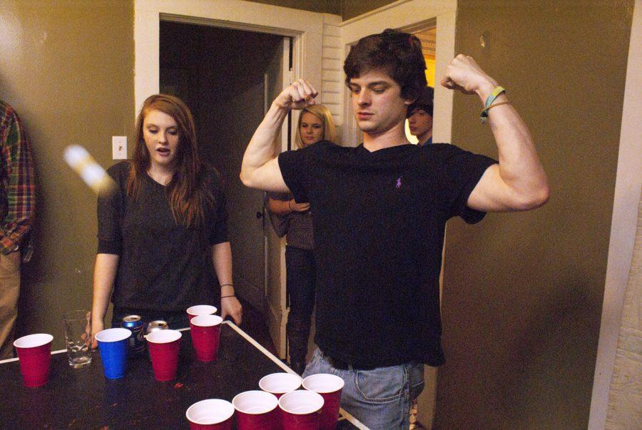 Sam Townson shows off during a game of beer pong Jan. 21 at a house party.