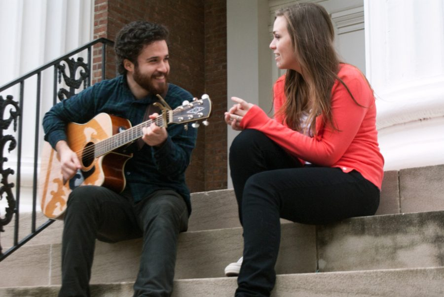 Noah Myers and Madeleine Frankford play music on the steps of Rogers Hall.