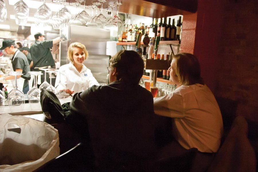 Rhiannon+Clark+bartends+at+City+Hardware+in+downtown+Florence.%0AThe+restaurant+has+only+been+open+for+three+weeks+and+has+been%0Asubject+to+mixed+reviews.%0A