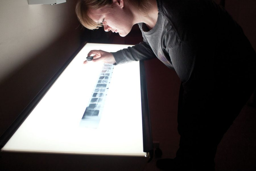 Jennifer+Newton+inspects+negatives+on+a+light+table+before%0Astarting+the+printing+process.+Methods+of+photo+development+are%0Aconstantly+debated+in+the+photography+field.+Newton+prefers+the%0Alabor+of+film+photography+to+the+digital+solution.%0A