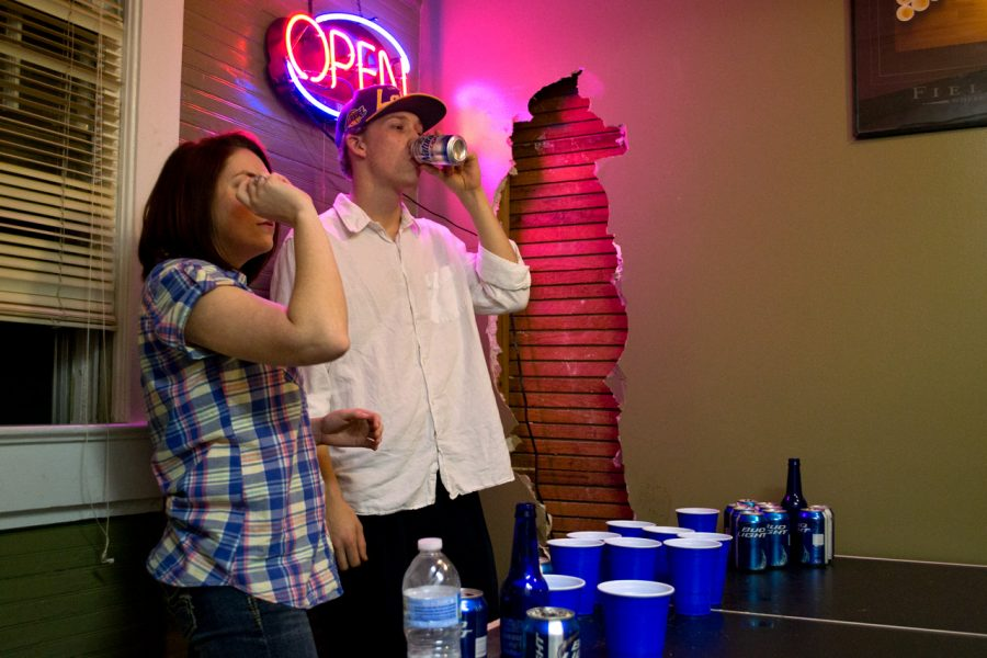 UNA students Samantha Foust and Wesley Hughes play beer pong at a party earlier in the year. Students at UNA are above the national average when it comes to drinking and driving or riding with an intoxicated driver.