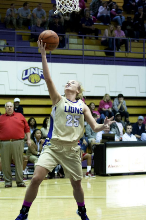 Senior+guard+Dana+Jackson+shoots+a+layup+during+a+game+earlier+this+season.+Her+and+the+Lions+go+into+the+tourney+after+a+huge+win+against+rival+UAH.%0A