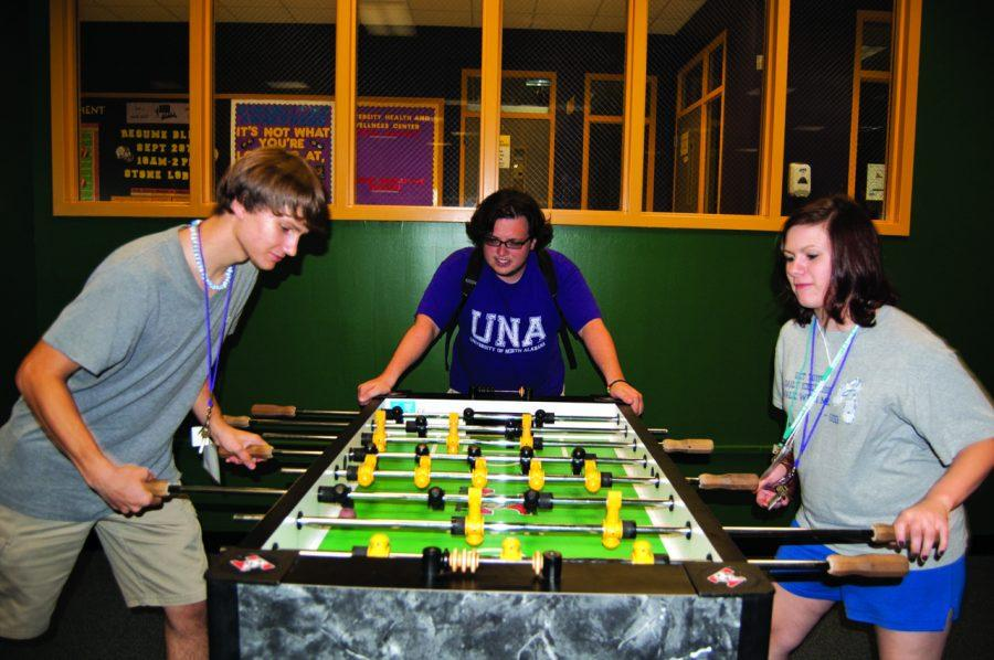%28From+left+to+right%29+Bobby+Martin%2C+Dillon+Green+and+Emily+Irvin+enjoy+playing+foosball+and+hanging+out+in+UNA%27s+game+room+located+in+the+GUC+at+last+year%27s+SOAR.%C2%A0%0A