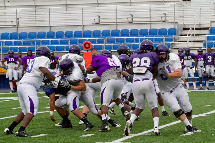 UNA players participate in a full contact scrimmage Saturday afternoon at Braly stadium.