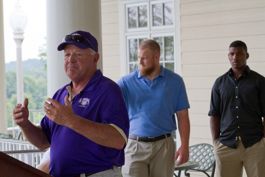 UNA+head+football+coach+Bobby+Wallace+speaks+to+the+crowd%C2%A0during+the+fall+media+luncheon+at+Robert+Trent+Jones+golf+course+Aug.+6.+Behind+Wallace+stand+outside%C2%A0linebacker+Will+Furlong+and+quarterback+Chris+Alexander.%C2%A0%0A