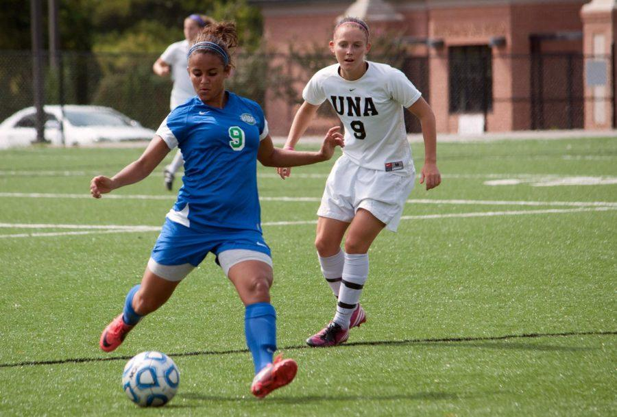 UWF%27s+Daniela+Cruz+sends+the+ball+up+the+field+Sept.+16+with+UNA%27s+Chloe+Roberts+right+behind+her.%0A