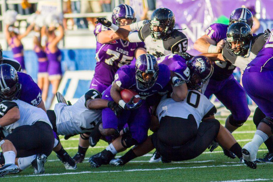 UNA's Lamonte Thompson (#24) finds himself in the middle of a pile while running the ball in the Sept. 8 game against Harding.