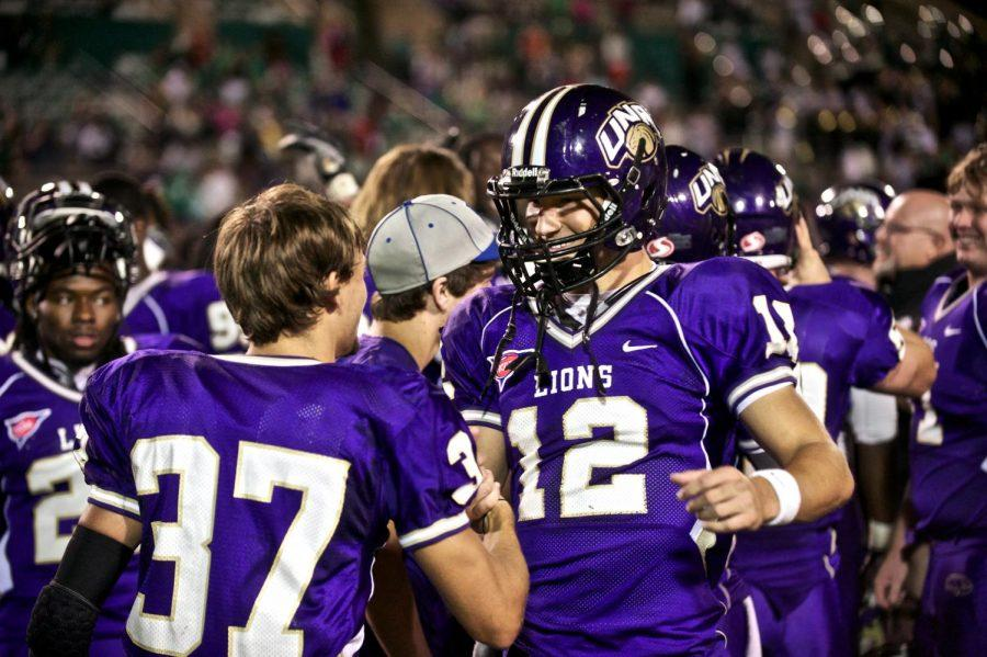 Freshman+quarterback+shakes+hands+with+junior+wide+receiver+Jason+Smith+the+Oct.+13+game+against+Valdosta+State+at+Braly+Stadium.+Wingo+played+in+his+first+game+as+UNA%E2%80%99s+starting+quarterback+against+West+Georgia+Oct.+18.+Wingo+accomplished+more+than+300+yards+of+total+offense+in+his+first+showing+as+a+college+starter.%C2%A0%0A