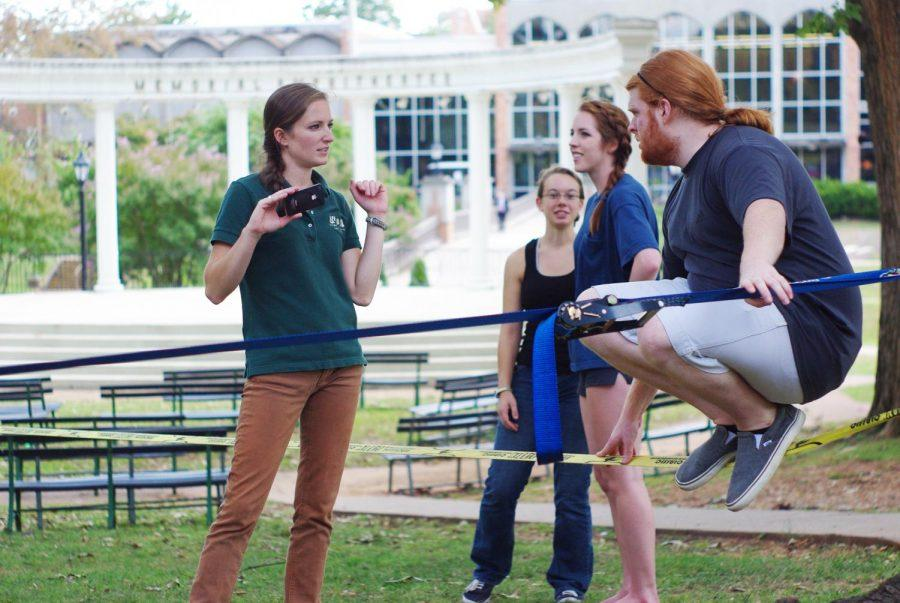 A+group+of+UNA+students+partake+in+slacklining+near+the+amphitheater+on+campus+Sept.+18.%0A