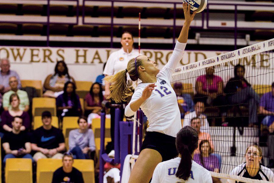 UNA middle hitter Taylor Chapman puts the ball over the net against Union University Oct. 5 at Flowers Hall. The Lions went on to win the game and also won their Oct. 6 game against Christian Brothers.