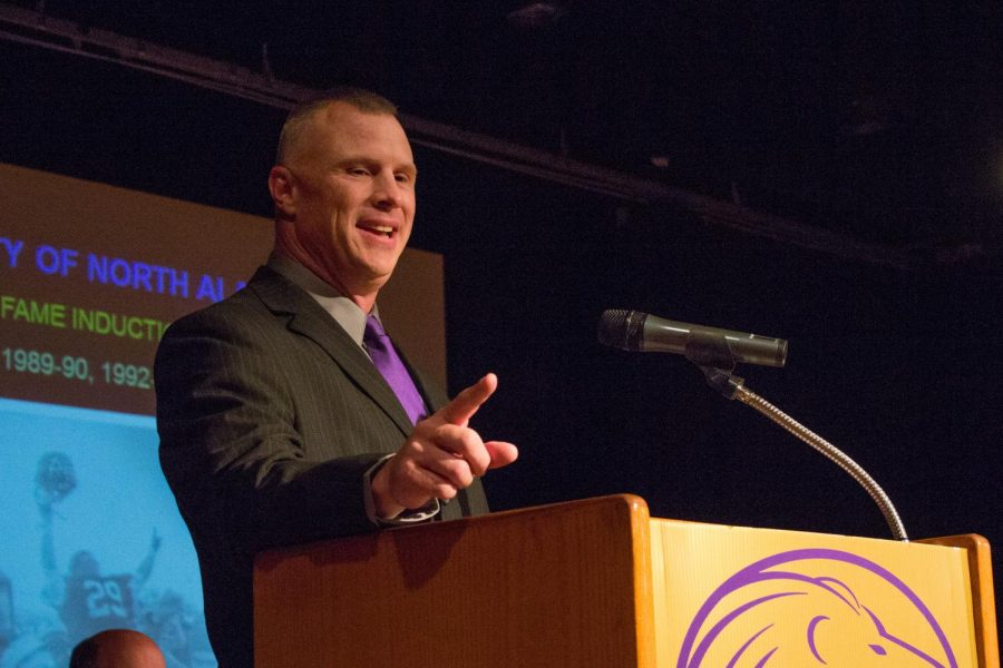 Hall of Fame inductee Brian Satterfield points to his family members in the audience during the Sept. 29 ceremony.