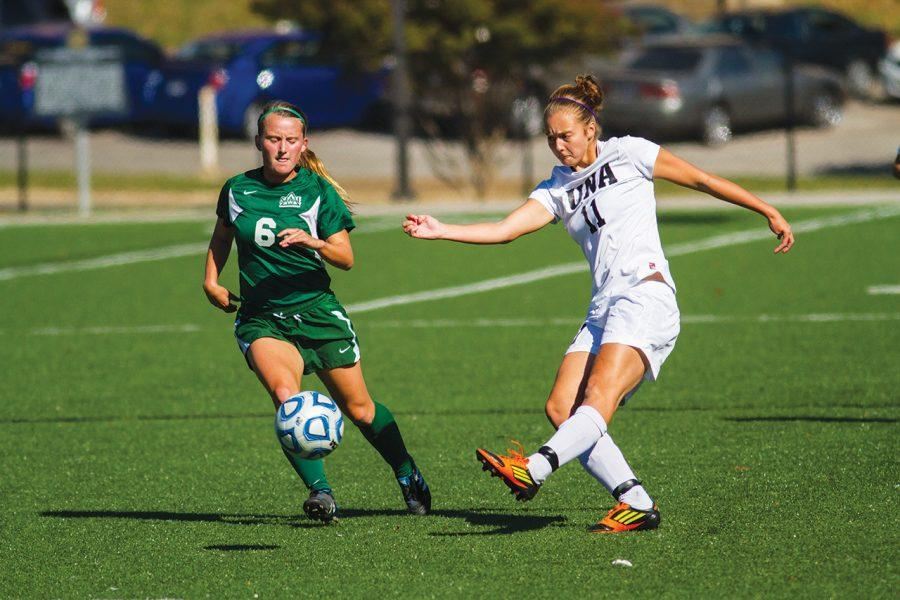 Chloe+Richards+kicks+the+ball+downfield+past+the+Statesmen%E2%80%99s+Jackie+Kelley+during+the+Oct.+28+game+against+Delta+State.%0A