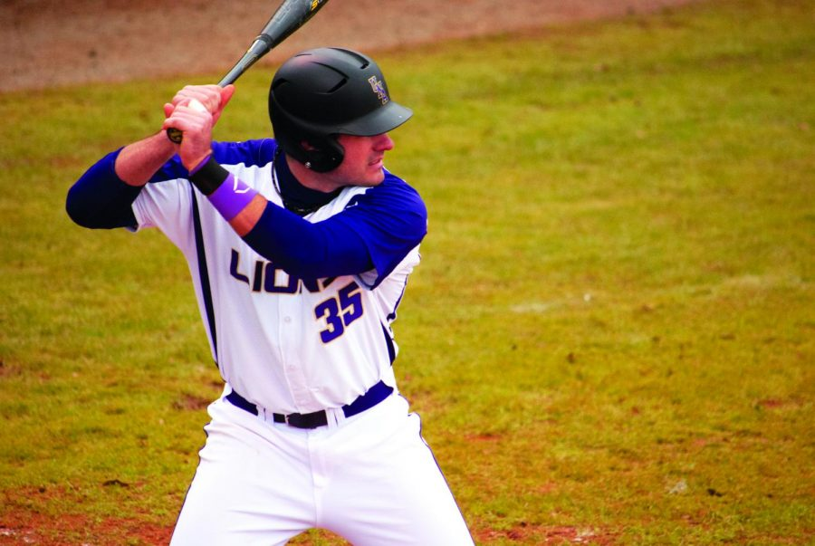 First baseman Josh Cyr is up to bat during the first baseball game of the season on Feb. 13.