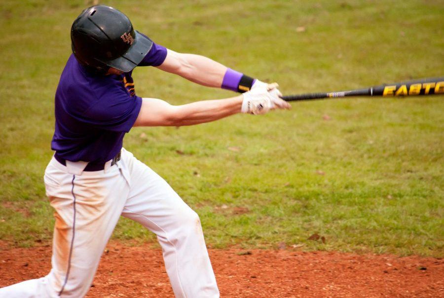 Josh Carpenter practices batting during the team's preseason practice on Jan. 29 at the UNA Baseball field.