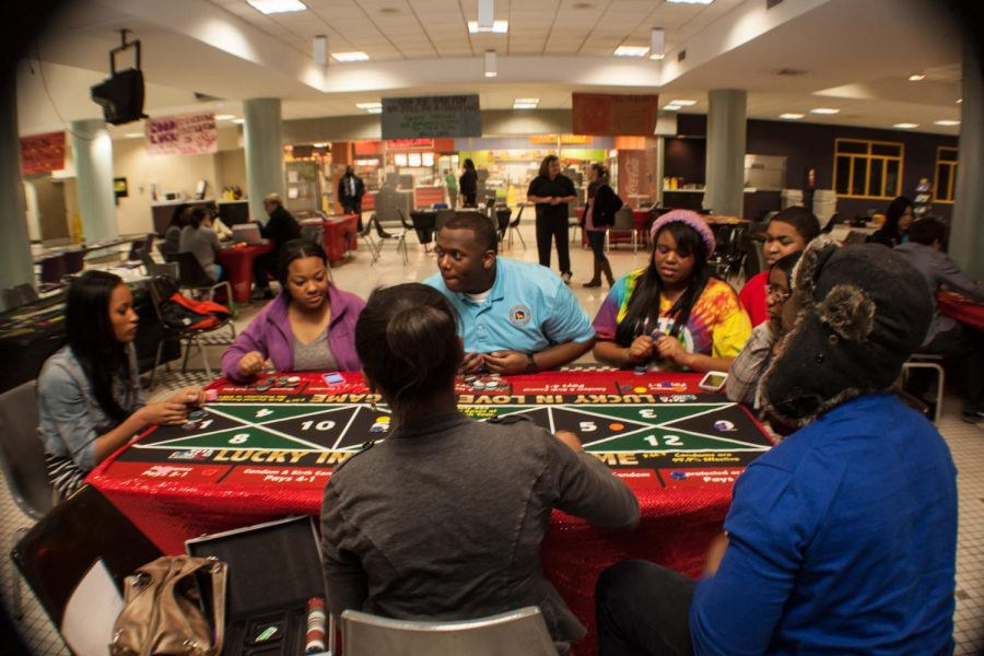 Students and members of UPC participate in Condom Casino in the GUC. The event was hosted by the programming organization and cost students approximately $4,000.