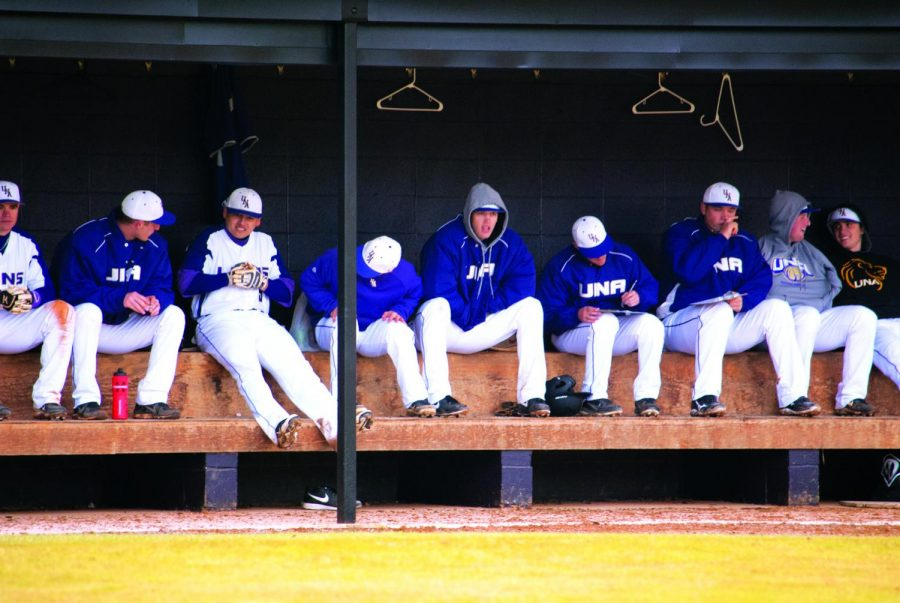 Members of the UNA Baseball team sit in the dugout during the season opener at home Feb. 13, in which the Lions swept LeMoyne-Owen in a doubleheader. The Lions went on to suffer a weekend sweep at Florida Southern College Feb. 23-24.