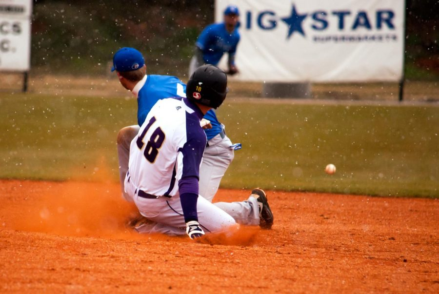 Outfielder Jake Ward slides into second base during the game against Shorter March 2. The Lions split a weekend series with the Hawks, winning two of three games.