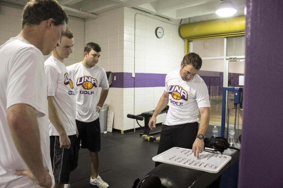 Members of the UNA golf team and Coach Stuart Clark work out in the weight room located in Flowers Hall. The UNA board of trustees approved $150,000 in university funds for the athletics department to build a new weight facility behind Hal Self Field House.