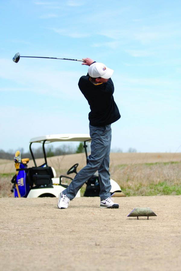 Trent Alexander stands with his club extended after driving the ball at the Jim Bishop Toyota Classic Monday, March 24.