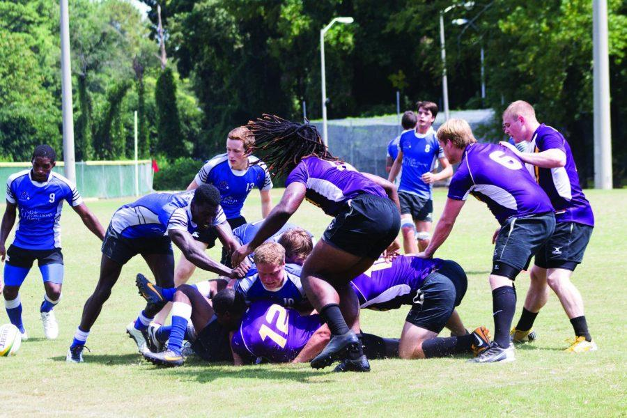 UNA and Memphis rugby players fight for possession of the ball in their game Sept. 6. Coach Roberts and the players are confident this season will be better than last.