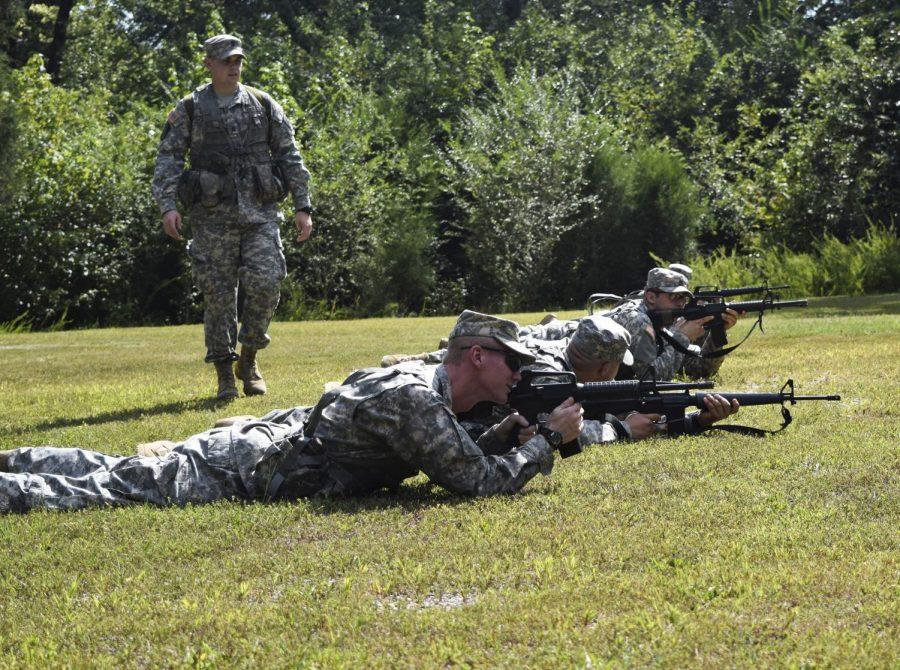 ROTC practicing their formation and firing methods.