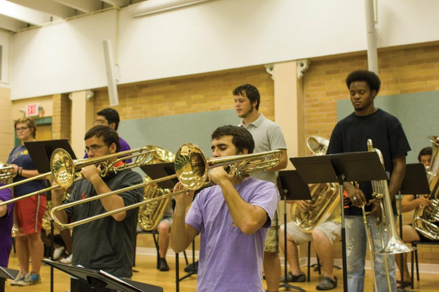 The+low+brass+section+practices+their+music+for+an+upcoming+concert.+Associate+Professor+of+Music+Terrance+Brown+said+he+believes+the+new+Bachelor+of+Music+degree+option+will+bring+more+students+to+the+music+department.