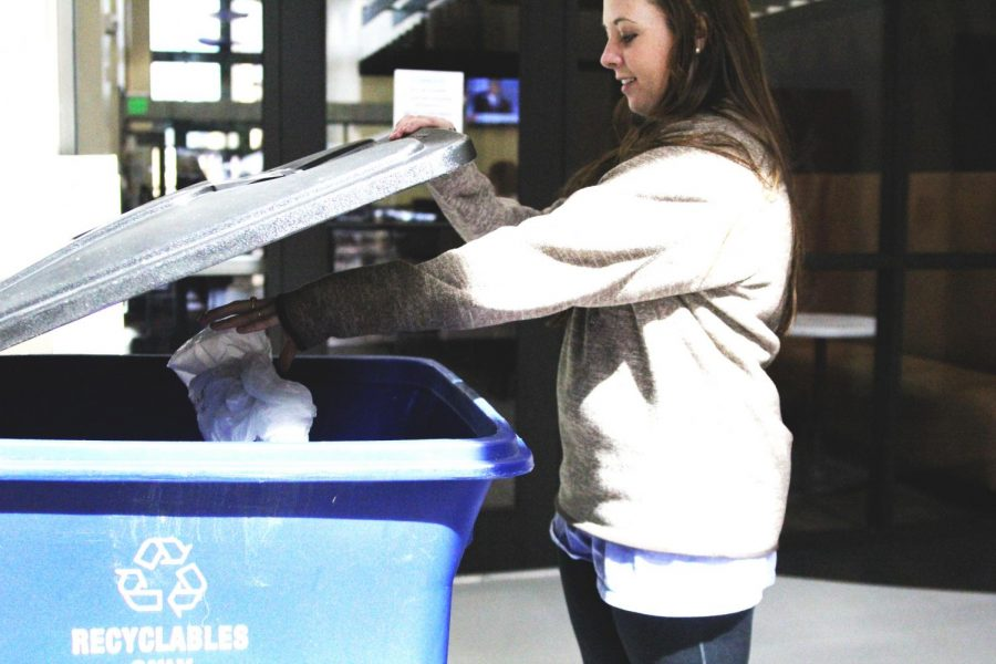 Junior+Kelsey+Woodman+throws+a+plastic+bag+into+an+on-campus+recycle+can.+Florence+Recycling+Coordinator+Rachel+Mansell+said+UNA+is+the+city%E2%80%99s+biggest+recycling+contributor.