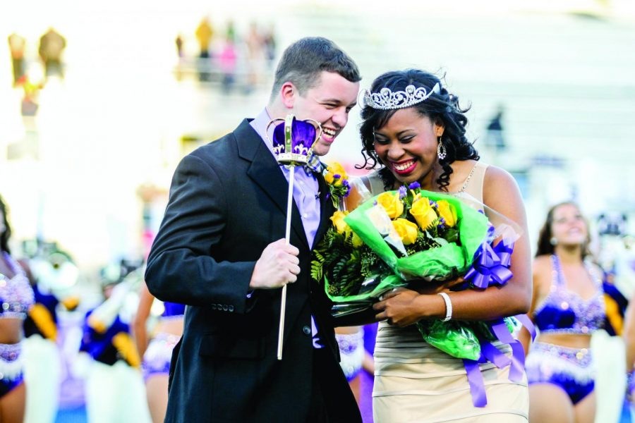 Nick+Lang+and+KeKoria+Greer+laugh+as+they+are+crowned+homecoming+king+and+queen+Oct.+4.