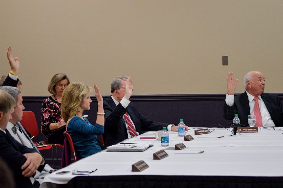 UNA trustees raise their hands to cast votes for Kenneth Kitts to be the next university president. The board offered Kitts the job after a 8-0 vote. Trustee and Presidential Search Committee Chairman Joel Anderson said Kitts was excited to hear he had been selected.