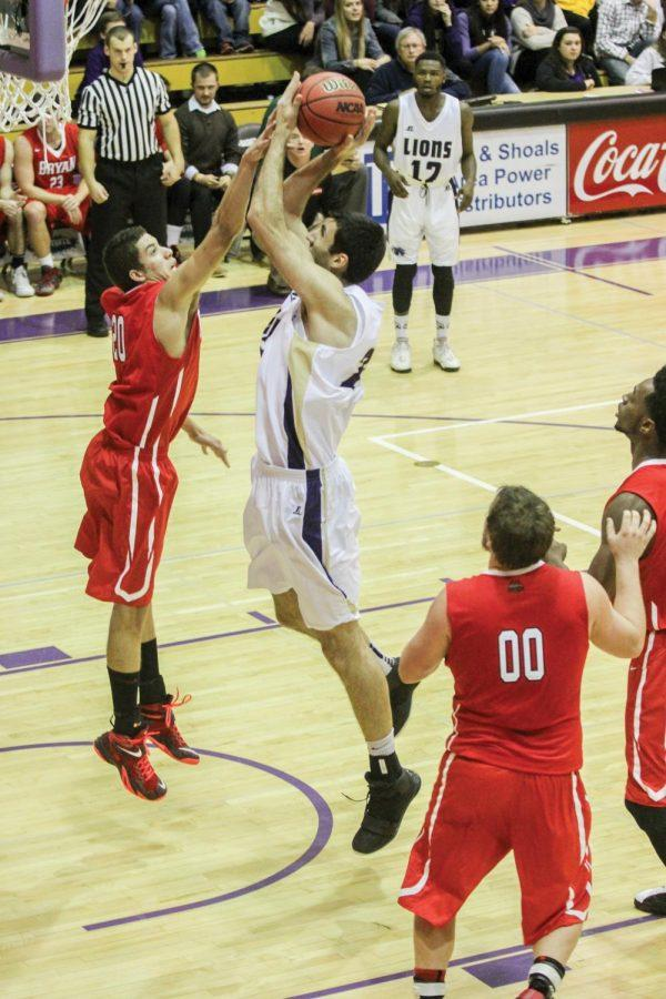 Junior forward Lazar Petrov pulls up for the shot against Bryan College Nov. 17. The Lions won 82-69.