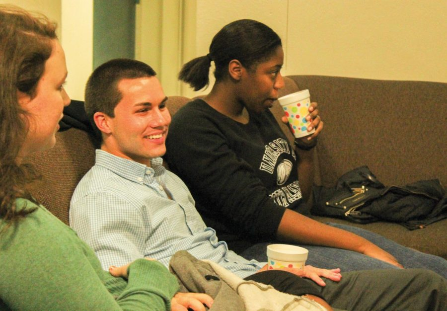 """Freshman Sara Lauderdale, Resident Adviser Derek Keasling and Resident Adviser Natasha Thomas socialize at """"Coffee & Chat,"""" a program hosted by Resident Adviser Justice Gilbert. The advisers host two programs per month to get students acquainted with residents on their floor."""