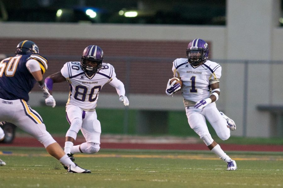 Sophomore+cornerback+Philbert+Martial+%28right%29+looks+for+running+room+after+fielding+a+kickoff+against+Mississippi+College+Sept.+13.+Martial+established+himself+as+a+shutdown+corner+and+dangerous+return+man+for+the+Lions.
