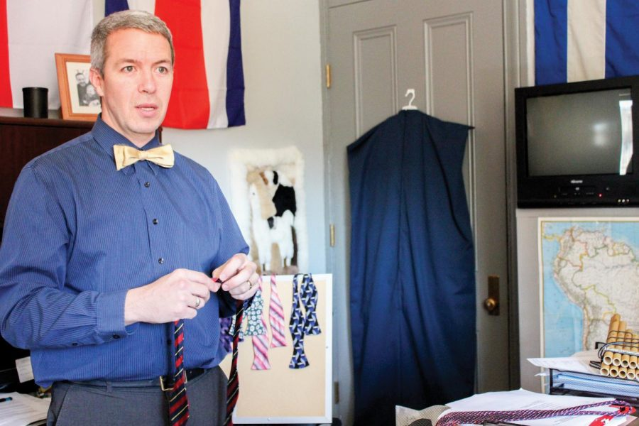 Scott+Infanger%2C+associate+professor+of+foreign+languages%2Cexplains+his+process+of+creating+bow+ties.+Infanger+uses+old+ties+to+make+his+bow+ties+from+scratch.+He+has+contemplated+selling+his+bow+ties+but+decided+against+it+because+he+said+it+would+become+a+job+and+no+longer+for+fun.