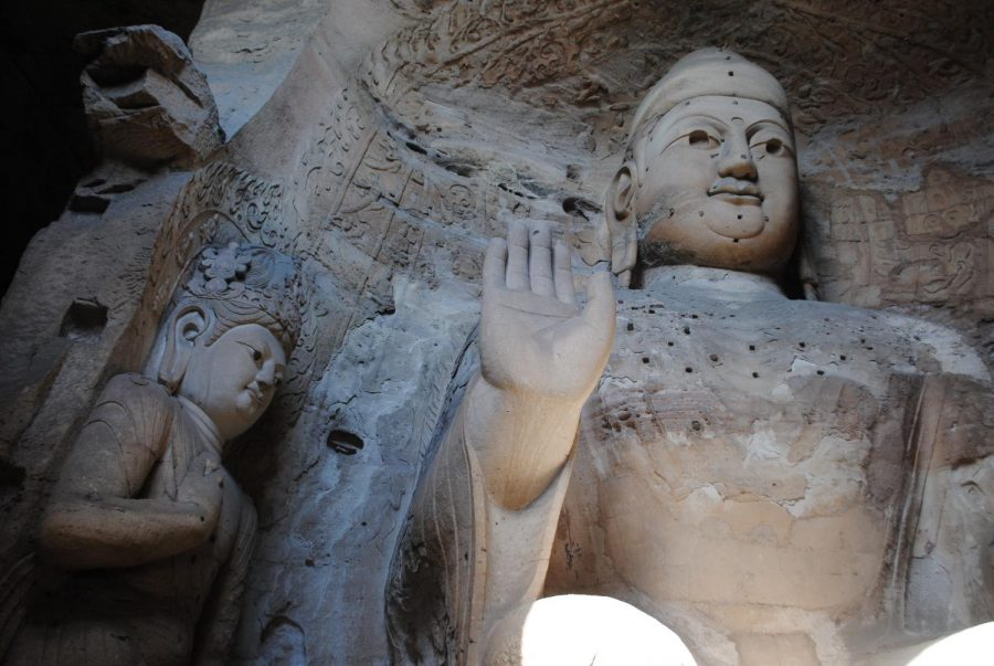 A+Buddha+carved+directly+from+the+wall+of+a+cave+in+the+Yugang+Grottoes+greets+visitors.