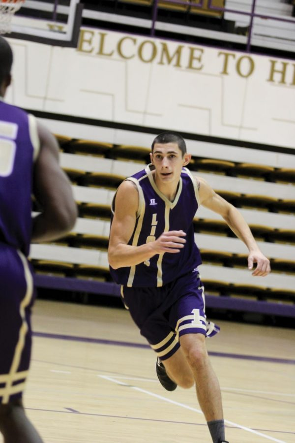 Junior forward Jere Vucica runs toward the ball during a practice drill Nov. 6. The Croatian native is one of the key returnees for the Lions.