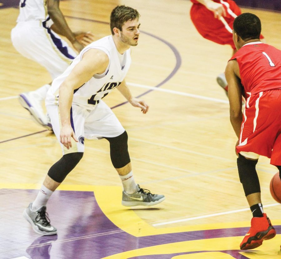 Senior guard Nathan Spehr plays defense against a Bryan College player Nov. 17. The Gulf South Conference schedule starts Dec. 4 for the UNA basketball teams as they host Valdosta State University.