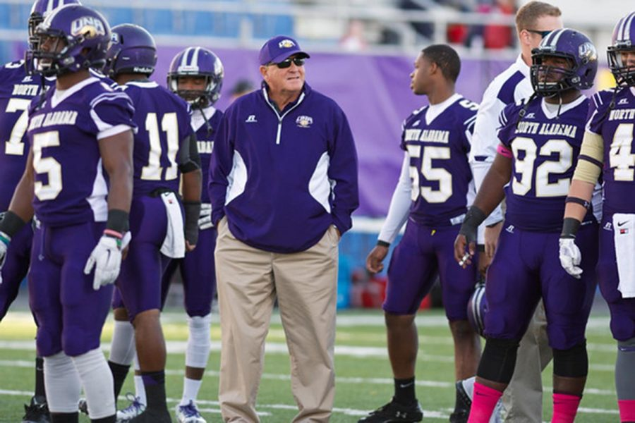 Football+head+coach+Bobby+Wallace+stands+among+football+players+at+the+Oct.+4%2C+2014+game+against+Western+Oregon+University+at+Braly+Stadium.+Wallace+is+the+highest+paid+head+coach+at+UNA%2C+making+%24108%2C869.04+per+year.