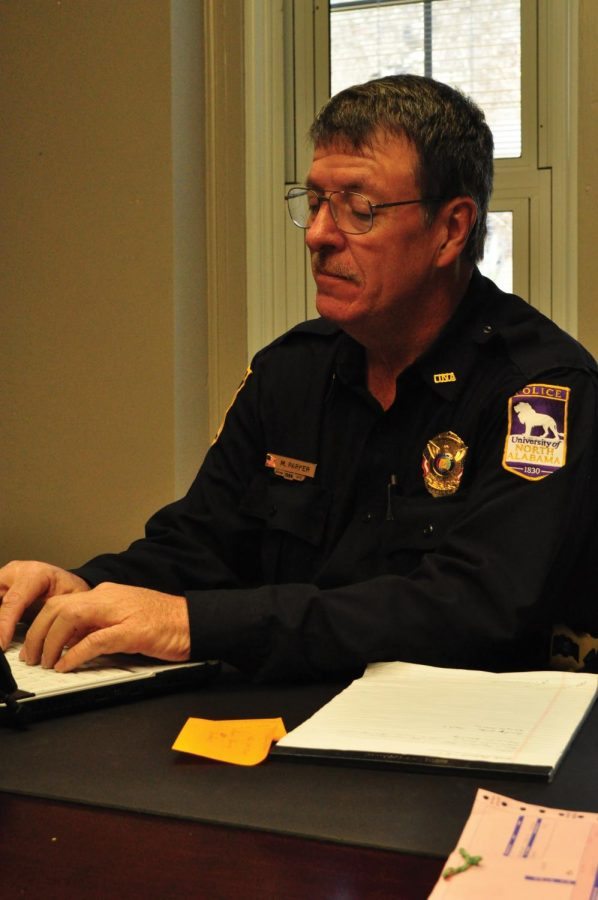 Interim Police Chief Mark Parker works at his desk in the UNA Police DepartmentJan. 6. Parker temporarily fills the position left vacant whenBob Pastula resigned Dec. 31.
