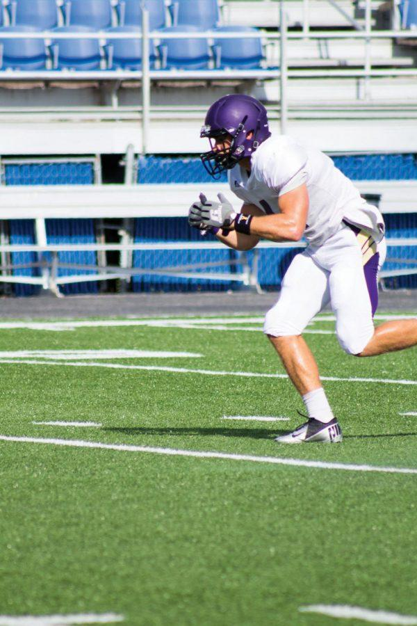 Junior wide receiver Lee Mayhall runs a route during practice Sept. 3, 2014. Mayhall was named to the 2014 Capital One Academic All-America first team Dec. 3.
