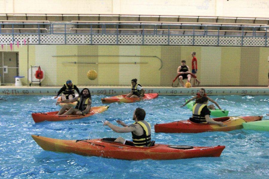 Senior Christian Walk getting ready to pass the ball to teammate Sophomore Alex Maxwell. The Outdoor Adventure Center hosts Kayak Polo every Thursday from 6:30-8:00 p.m. in the Flowers Hall pool.